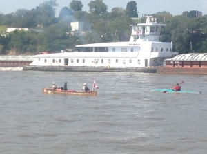 The Canoers next to a tow on the Mississippi  - they are VERY strong rowers!