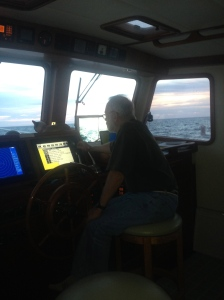 At the helm at dusk on the Gulf