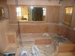 Starboard side of the saloon and seating area; TV will pop up behind the settee!